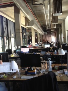 A large open space houses the workers, including founders.